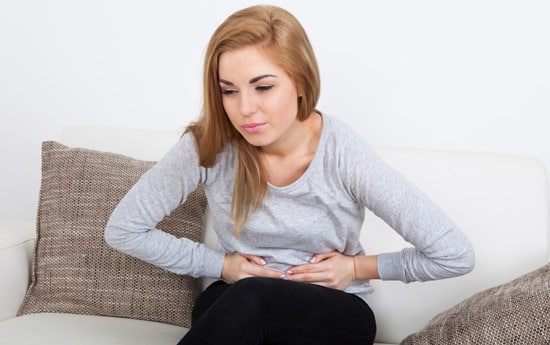 young-woman-with-bloated-stomach